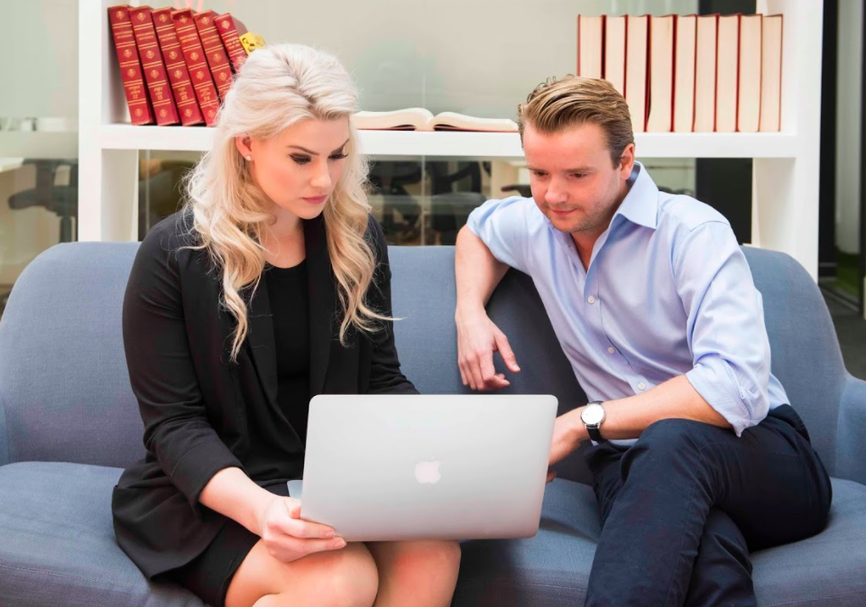Two business people looking at a laptop