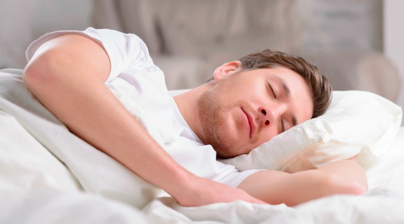Man sleeping in bed