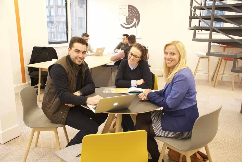 People sat in a room having separate meetings