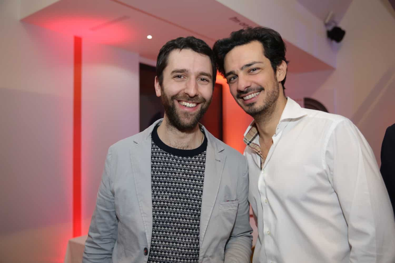Two men smiling for a photo