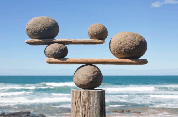 stones balanced on sticks photo