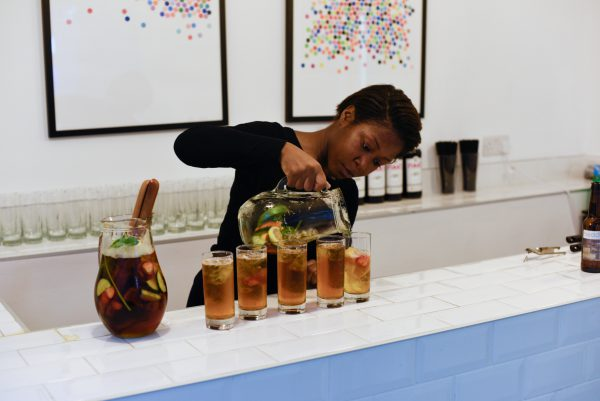 Barwoman Pouring Refreshments