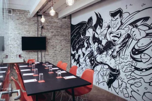 Meeting Room with Batman and Superman Mural