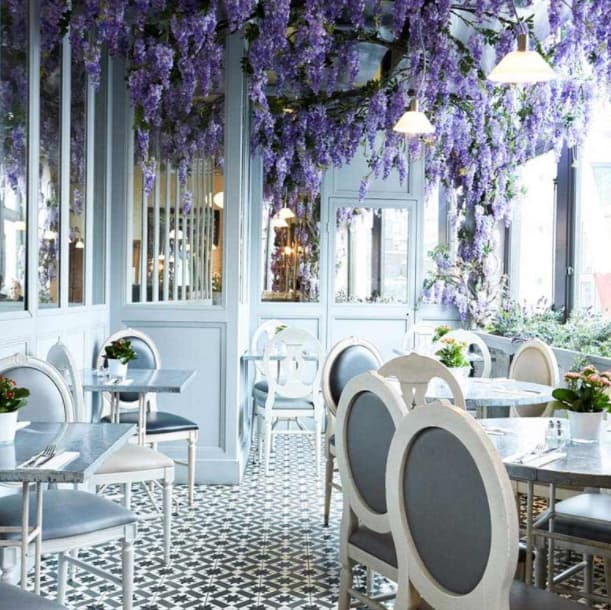 Stylish dining area with lavender tree hanging from the roof