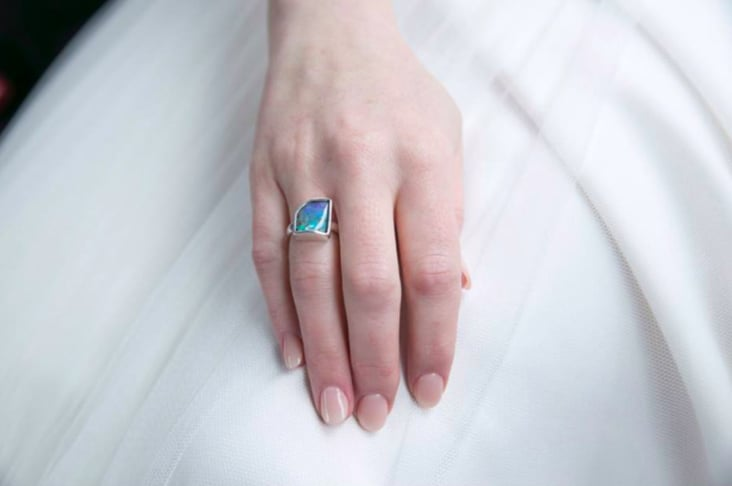 Ring on a hand against a dress