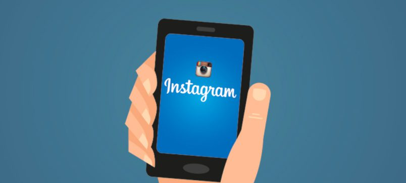 Animation-styled hand hold a phone with the Instagram logo on it